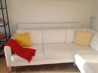 IKEA white corner sofa with additional white seat covers