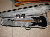 Washburn x-series guitar with amp, case and cord