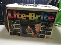 1990 Lite Brite with Box, Pegs & Design Papers.   Comes with or