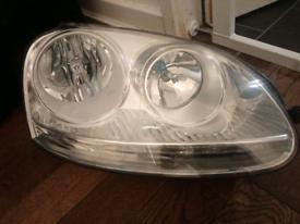Vw jetta head light left