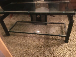 "TV STAND. LIKE NEW. Holds a 65"" plasma"
