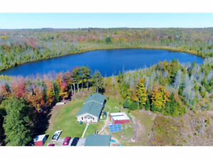100 ACRES WITH LAKE AND HOUSE AND GARAGE