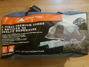 8 person Ozark Trail tent/camping set + extra chair. Used once
