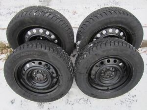 """Four 15"""" STUDDED snow tires excellent condition, on steel rims"""