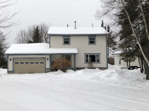 Custom built 2 story home with detached garage for sale