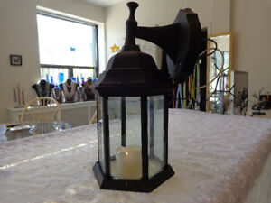 Outdoor, wrought iron wall lantern,with beveled glass.