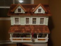 Doll House with furniture and dolls plus accessories.
