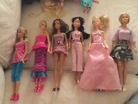 12 beautiful very good condition dolls. Some are missing shoes