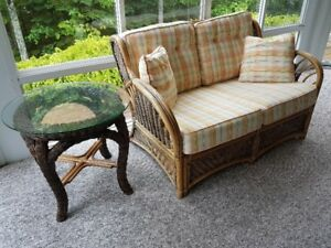Love seat and 2 club chairs and 2 tables in rattan.