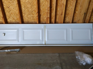Two 8 foot non-insulated garage panels for scrap metal