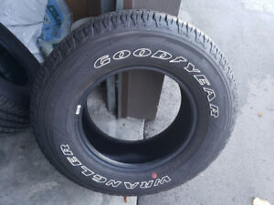 FOUR BRAND NEW GOODYEAR 265/70R17 TIRES.