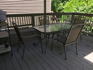 Outdoor metal & glass dining table and 4 chairs good condition