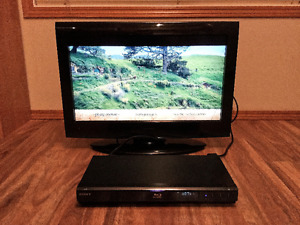 26 Inch Toshiba TV With Blu-Ray Player and Movies.