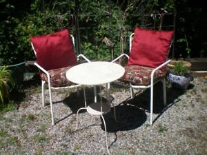 table and chairs and outdoor rocking loveseat