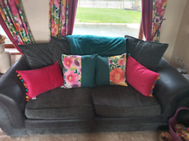 Charcoal grey & black living suite 2 seater,4 seater sofas & cuddle