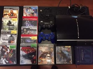 PS3, 2 controllers, and 27 Games