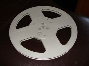 One empty plastic 10.5 x 1/4 inch reel for recording tape