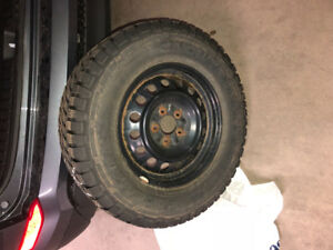 Pacemark Snowtrakker 235 70R16 Winter Tires on rims for sale!