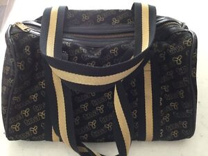 TNA Black and Gold accent purse