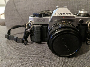 Canon AE1 with FD 50mm, f1.8, including flash, filter, and lens'