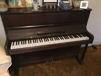 Breskal upright piano. Great to good home