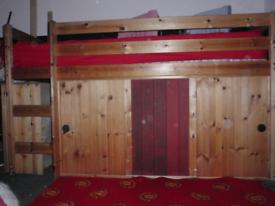 MID-SLEEPER BED WITH STORAGE BELOW.