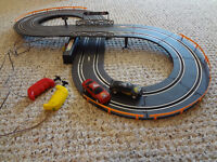 $20 - Almost NEW Scalextric car race with counting tracks.