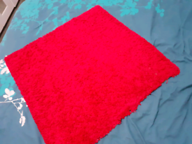 Small red square IKEA rug.