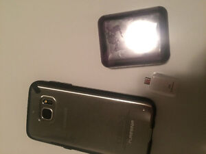 Samsung s7 brand new lock to virgin  coms with screen protection