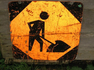 "Old ""Men at Work / Construction"" Sign Well Used"