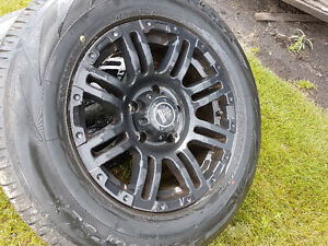 Set of 4 Black Iron Rims and Tires