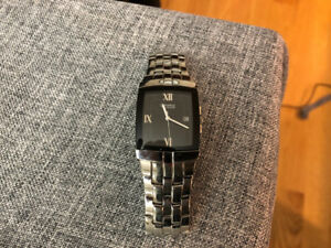Caravelle by Bulova - silver watch w/ black face watch