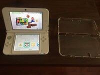 White Nintendo DS 3DS XL console with 15 3DS games and clear outer case