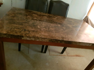 Man made granite table and 6 chairs