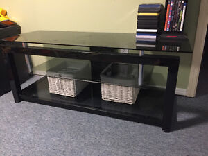 Mint condition tv stand , light steel and tempered glass.