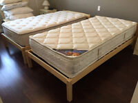 Single beds with mattresses