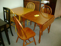 New drop leaf table and two chairs. $449.