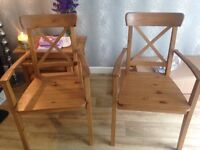 Two IKEA Ingolf chairs with arm rests