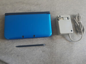 Blue Nintendo 3DS XL with lots of games, pen, and charger
