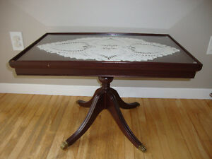Antique glass top claw and ball coffee table