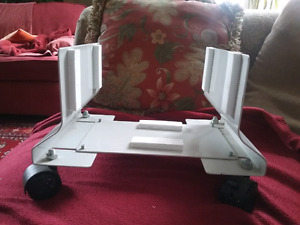 Computer tower stand on wheels
