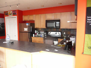 Trendy inner city corner top unit with loft in South Calgary