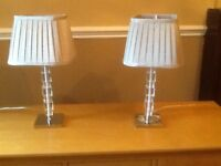 set of lamps with chrome base and pleted lamp shades