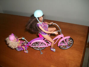 Barbie and sister on bike