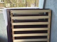 Solid wood brown cot £30
