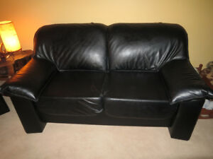 Classic black leather couch, in perfect condition