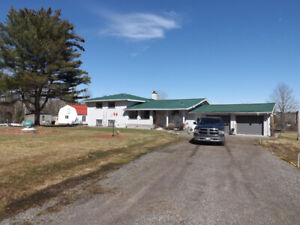 MLS# 2068859-All brick country home w/ barn and 190+ acres