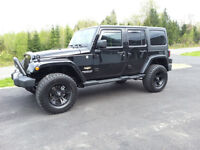 One of a kind...2014 Jeep Wrangler sahara unlimited blacked out