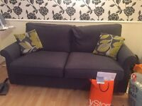 Sofa with pouffe