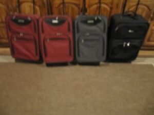 4 Carry On size suitcases